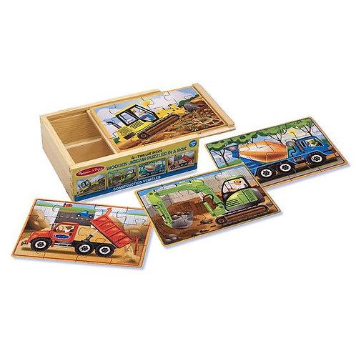Caja con 4 Rompecabezas de Vehículos de Construcción