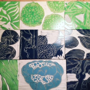 Inked up lino blocks for PBS International
