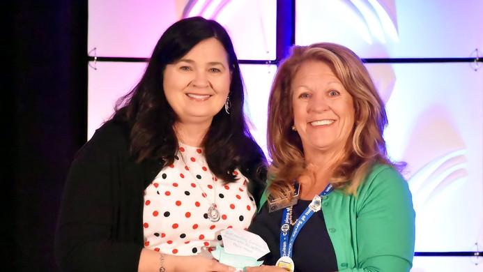 Kelli Warren, Cumming Club Accepts Award