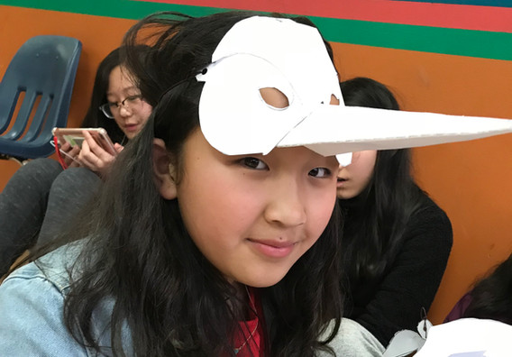 Himalayan Heritage Student in Queens wearing a crane mask inspired by our Lhamo Trung Trung story and made by her.