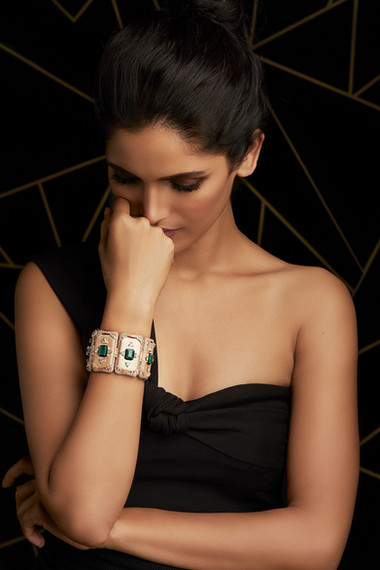 GEOMETRIC PRECISION MEETS ARTISTIC EXCELLENCE IN THIS DIAMOND & EMERALD HAND CUFF, WITH BRUSHED GOLD FINISH.