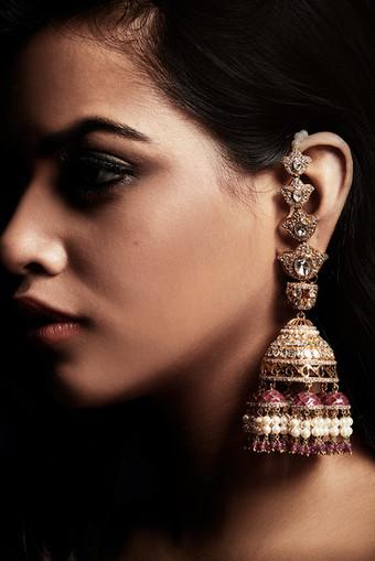 Dramatic diamond polkis and ruby earrings.