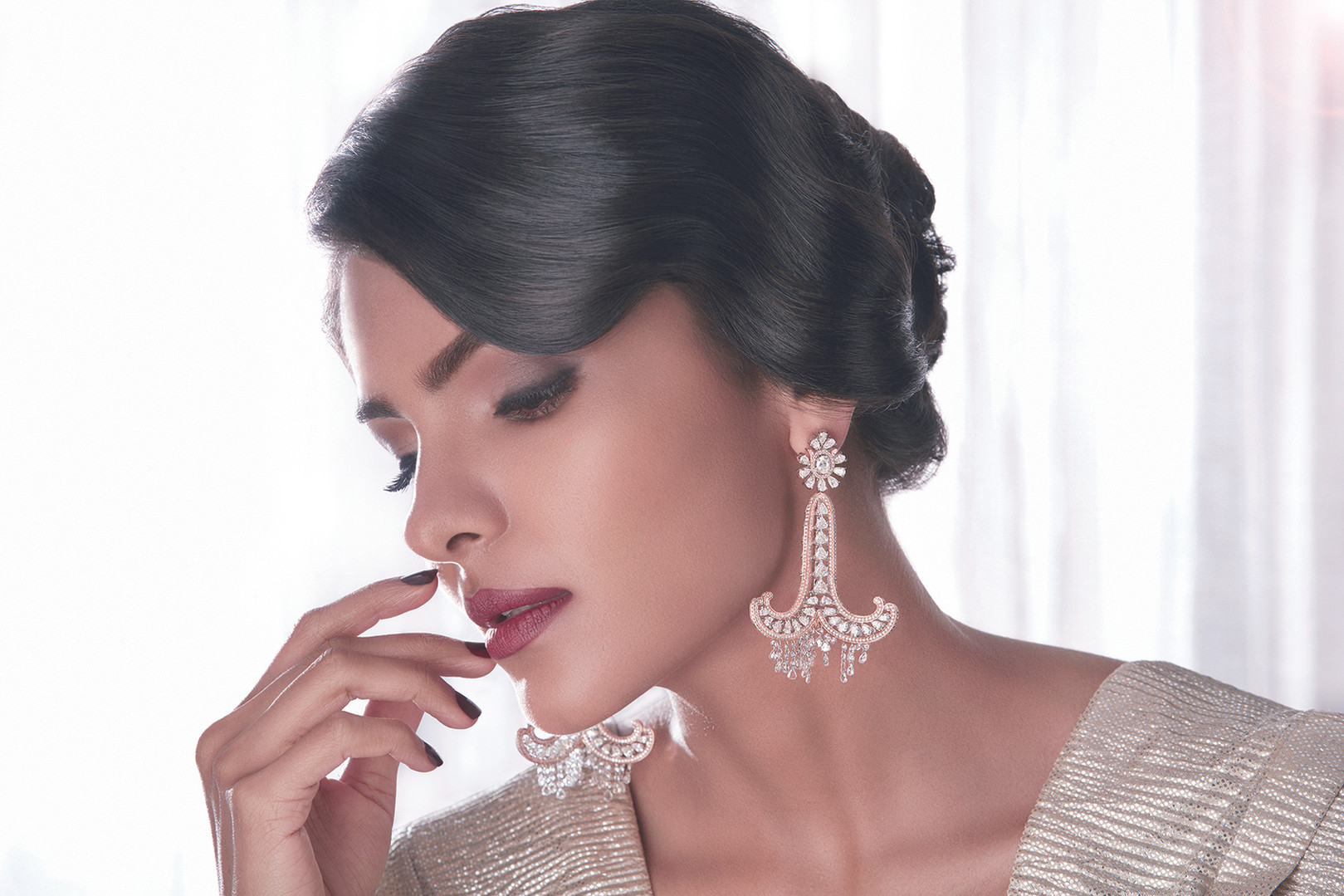 Statement chandelier earrings with diamonds.