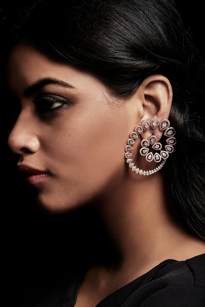 One-of-a-kind earrings featuring pear shaped diamonds over two-tones of gold.