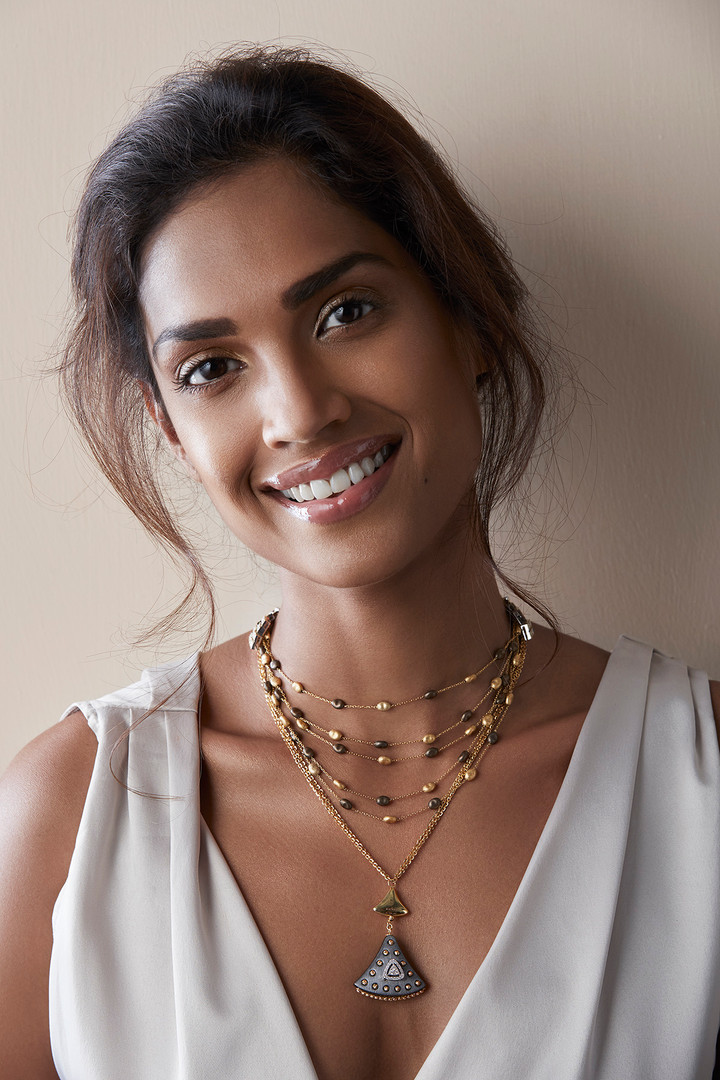 NECKLACE: Layers upon layers of linked fine chains in varying lengths, paired against superlative form and texture - true Italian mastery.  PENDANT: Lustrous gold and exquisite diamonds featured in a design that becomes the modern beauty.