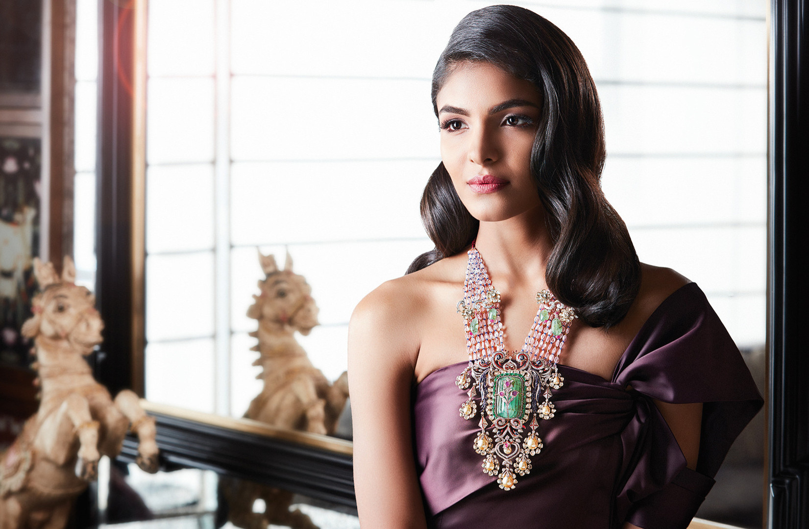 Amalgamation of tradition and modernity; statement neckpiece with diamond, polki and other natural gemstones.