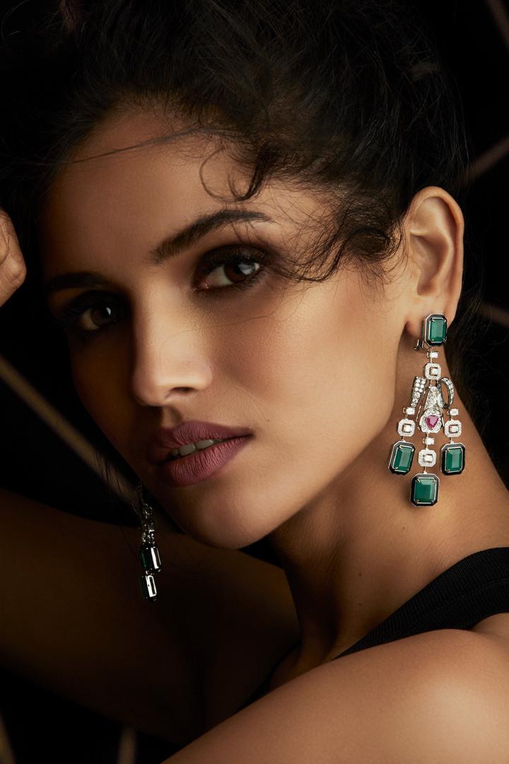 ELEGANT & EXPERIMENTAL EARRINGS CRAFTED WITH DIAMONDS, EMERALDS & BLACK ENAMEL.