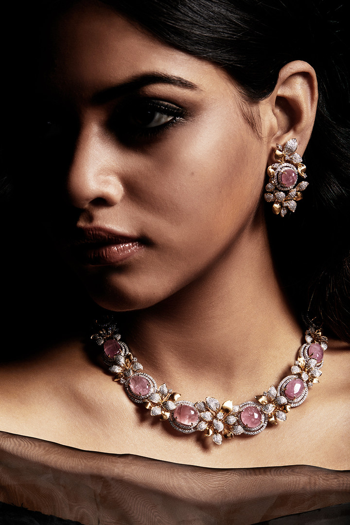 Cabochon-cut burmese pink spinel with diamonds.