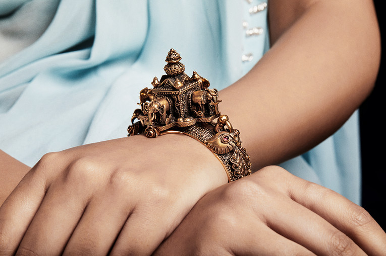 An intricately hand-crafted gold kada in the enigmatic tradition of temple jewellery.