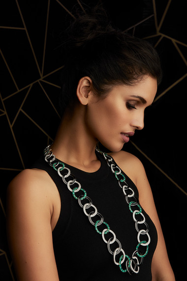 AN EXCEPTIONAL STATEMENT NECKLACE FEATURING DIAMONDS, EMERALDS & BLACK ENAMEL.