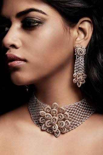 Statement diamond choker and earring suite, intricately hand-crafted over two-tone gold.