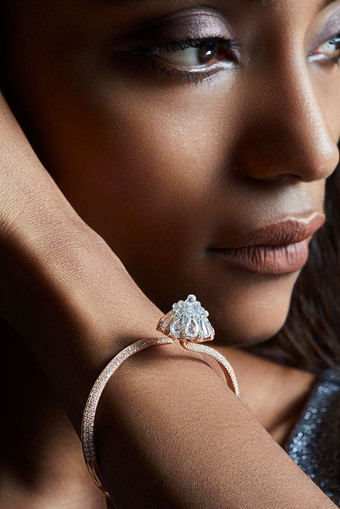 Rose-cut white diamonds with cognac diamond briolettes come together aesthetically to reveal a perfect lotus bud, as the highlight of this delicate piece.   Featuring a bud-like lotus motif.