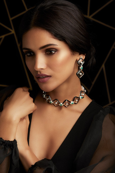 CONTEMPORARY FORM INFUSED WITH ARTISTIC MASTERY; FEATURING DIAMONDS, EMERALDS , CRYSTAL & BLACK ENAMEL.