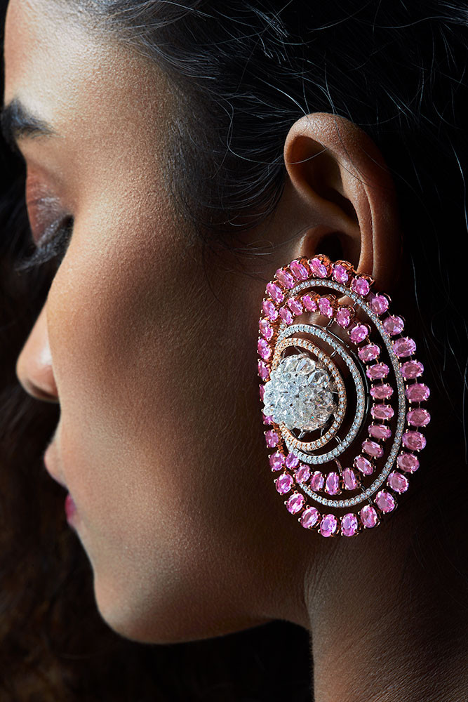 Ravishing pink sapphires with brilliant cut diamond accents make this pair truly exceptional. Rose-cut, pear-shaped diamonds and diamond briolettes create the ethereal lotus at the centre.  Featuring a blossomed lotus motif.
