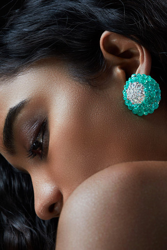 Briolette-cut emeralds with rose-cut diamonds and white diamond briolette create a vibrant pair of earrings, aglow with the gorgeous green of the emeralds.  Featuring a blossomed lotus motif.