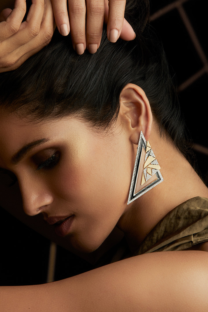 ARRESTING TRIANGULAR EARRINGS CRAFTED WITH DIAMONDS & CRYSTAL, FURTHER LAYERED WITH BLACK ENAMELLING & TWO-TONE GOLD.