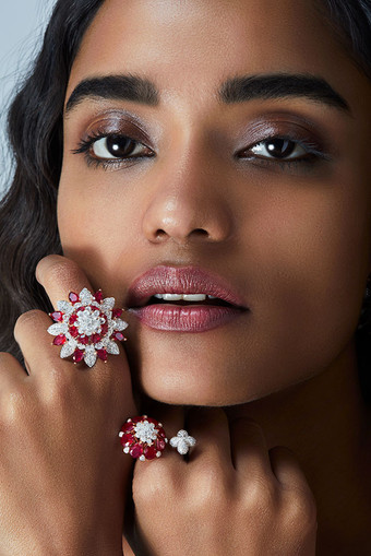 Lotus-inspired asymmetric ring (bottom right) composed of rubies, full-cut diamonds and diamond briolettes. The signature formation gets a new spin through the variation in form, bringing novelty to the collection.   Featuring a bud-like lotus motif.