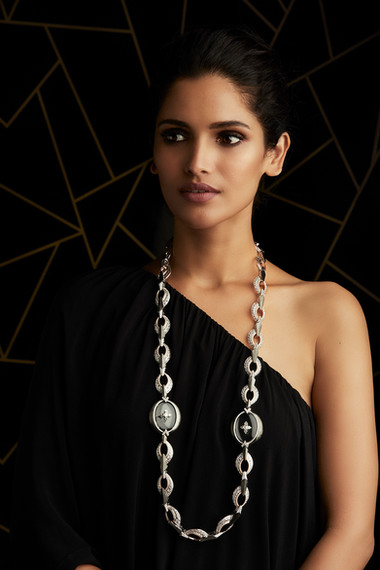 DRAMATIC DECO BEAUTY IN A NECKLACE CRAFTED WITH DIAMONDS & CRYSTAL, AS WELL AS CHARCOAL GREY METALLIC ENAMELLING.