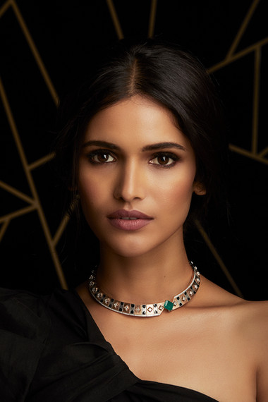 DIAMONDS & EMERALDS SHINE THROUGH A STUNNING ART DECO NECKLACE, WITH BLACK ENAMEL IN TWO-TONE GOLD & BRUSHED GOLD FINISH.