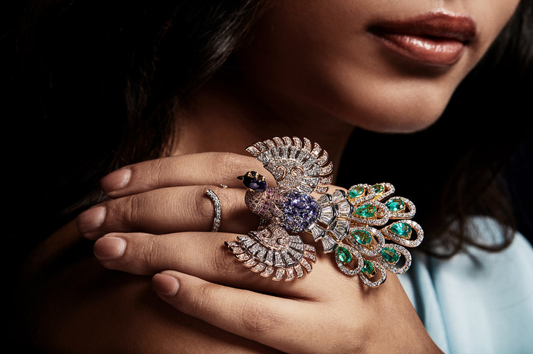 Poetic, enticing signature ring with pink sapphires, iolite, emeralds and diamonds over three-tones of gold.