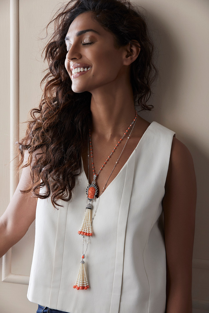 CHAIN (Top): Coral pendant with minute hand-carved detailing, featuring diamonds and black onyx.  CHAIN (Bottom): A dainty tassel pendant and chain for that exceptional flair, captured in the stackable style.