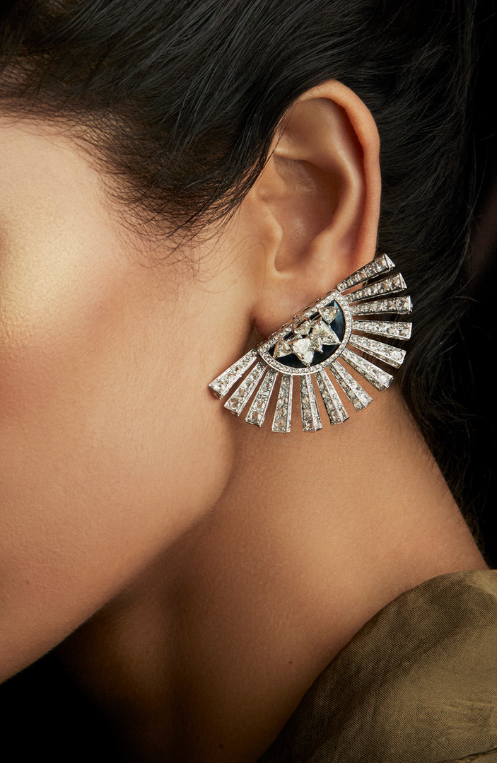AN ICONIC PAIR, IN ROSE-CUT ROUND & FULL-CUT TRILLION DIAMONDS, FEATURING METALLIC TEAL ENAMELLING.