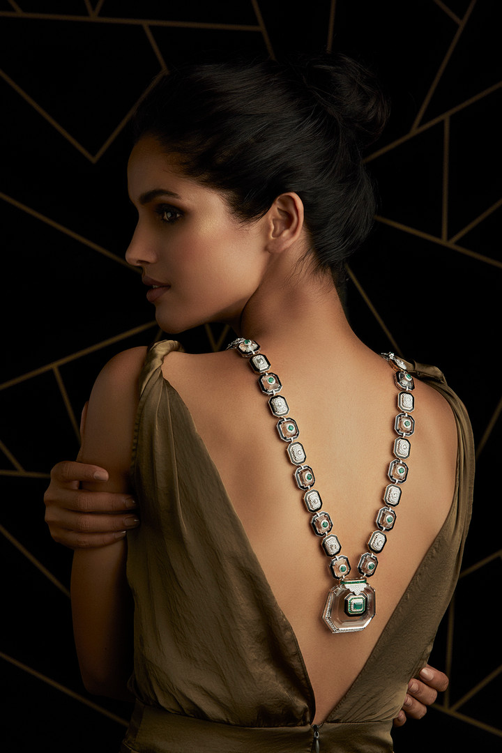 A STUNNING DECO NECKLACE FEATURING DIAMONDS, EMERALDS, CRYSTAL & BLACK ENAMEL.