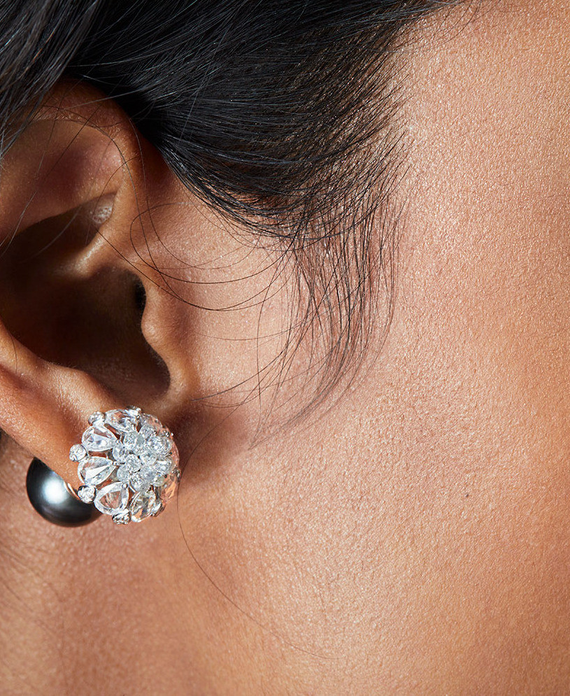 Graceful earrings featuring rose-cut diamonds, diamond briolettes. The highlight of the pair is the use of South-Sea pearls that instantly add novelty to the design.                                                                  Featuring a bud-like lotus motif.