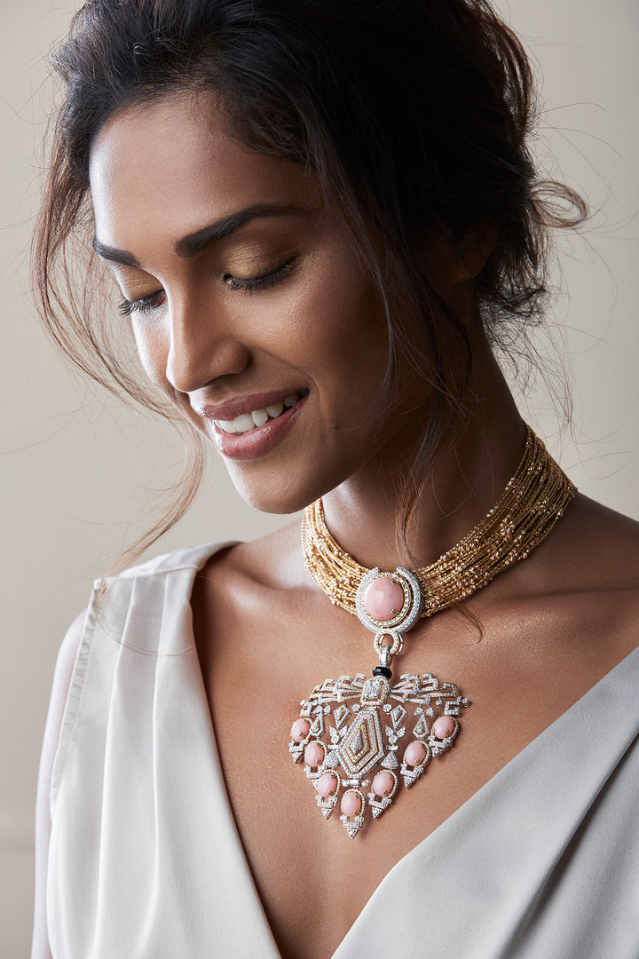For the belle of the ball: a pink opal and diamond choker with intricately-crafted layers of gold chains, stacked together for a statement collar piece.