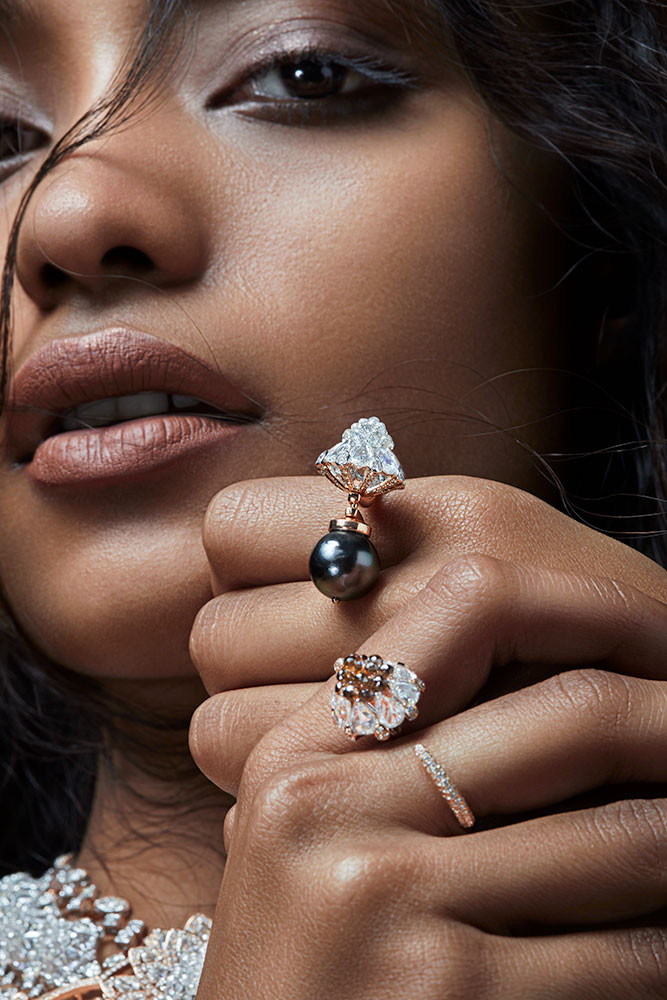 Stylish ring featuring rose-cut diamonds, full-cut round diamonds, diamond briolettes, and a blue South-Sea pearl. Crafted in rose gold with a superlative high-gloss finish.   Featuring a bud-like lotus motif.