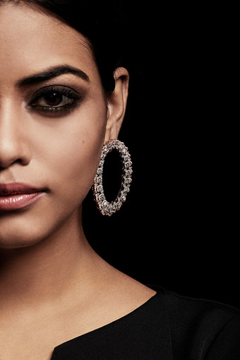 Stylish hoop earrings composed of assorted shapes of diamonds.