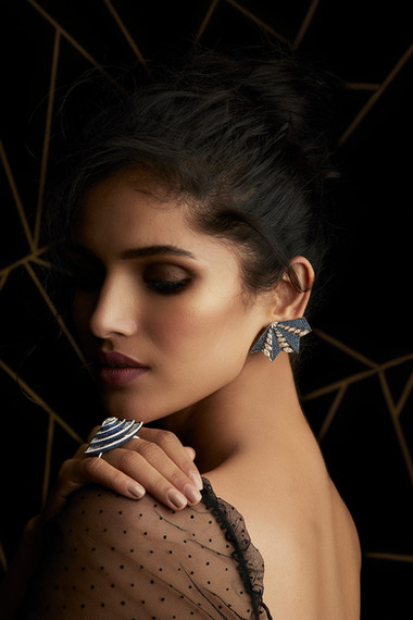 EARRINGS: SUPERLATIVE GEOMETRY CRAFTED WITH MARQUISE DIAMONDS & TANZANITES. RING: UNIQUELY-SHAPED IMMACULATE DESIGN, FEATURING WHITE & BLACK DIAMONDS & TANZANITES.
