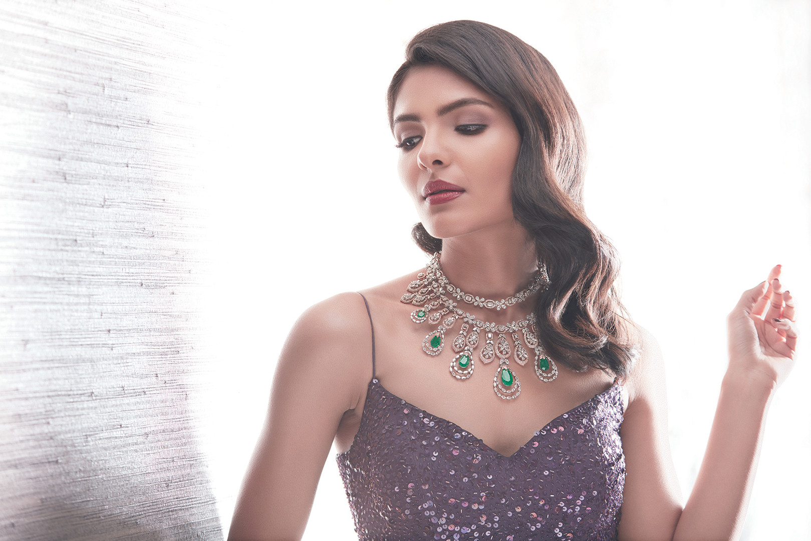 A glamorous necklace featuring emeralds and diamonds.