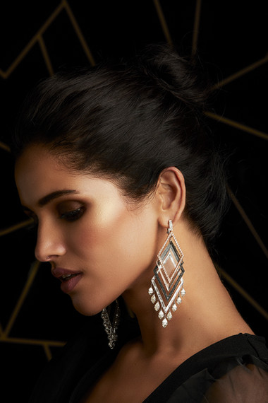 THE LIGHT PLAYS WITH THE LAYERS, ILLUMINATING BRILLIANT WHITE DIAMONDS, BLACK DIAMONDS & CRYSTAL - SET IN TWO-TONE GOLD.