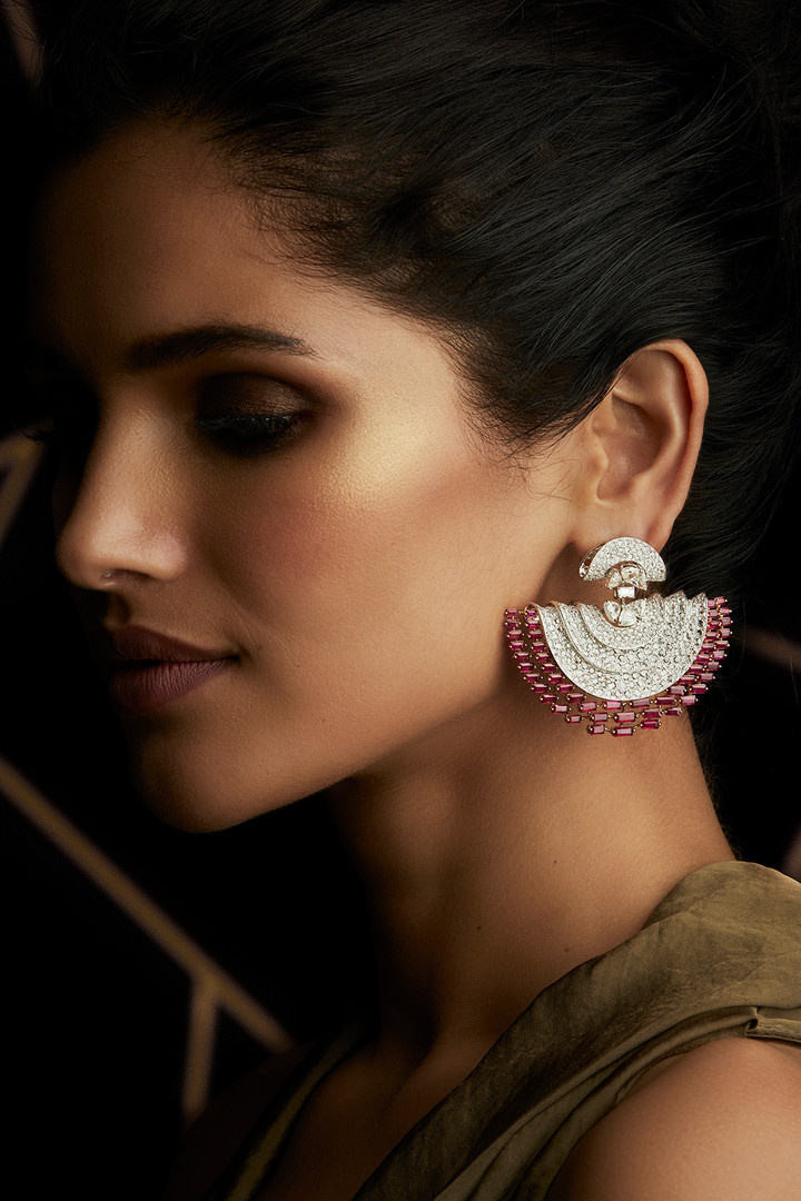 EXQUISITE EARRINGS METICULOUSLY CRAFTED WITH DIAMONDS & MOZAMBIQUE RUBIES.