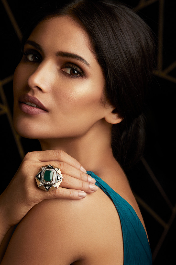 CONTEMPORARY STAR-LIKE DECO RING CRAFTED WITH DIAMONDS & A MAJESTIC EMERALD, LAYERED WITH BLACK ENAMEL & BRUSHED GOLD FINISH.