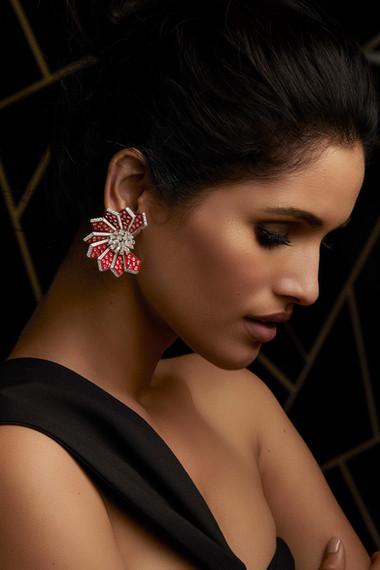 BOLD DIAMOND EARRINGS IN DRAMATIC FAN-LIKE FORMATION, CRAFTED IN PIGEON BLOOD RED ENAMEL.