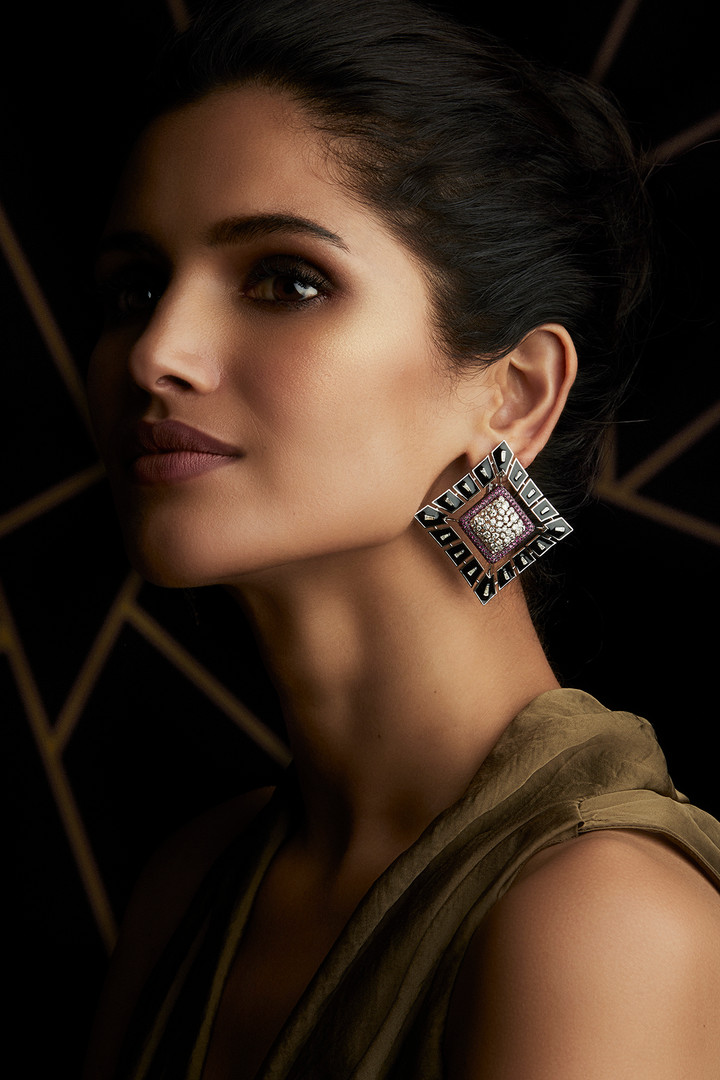 EXCEPTIONAL URBAN STYLE WITH EARRINGS FEATURING DIAMONDS, MOZAMBIQUE RUBIES & BLACK ENAMELLING.