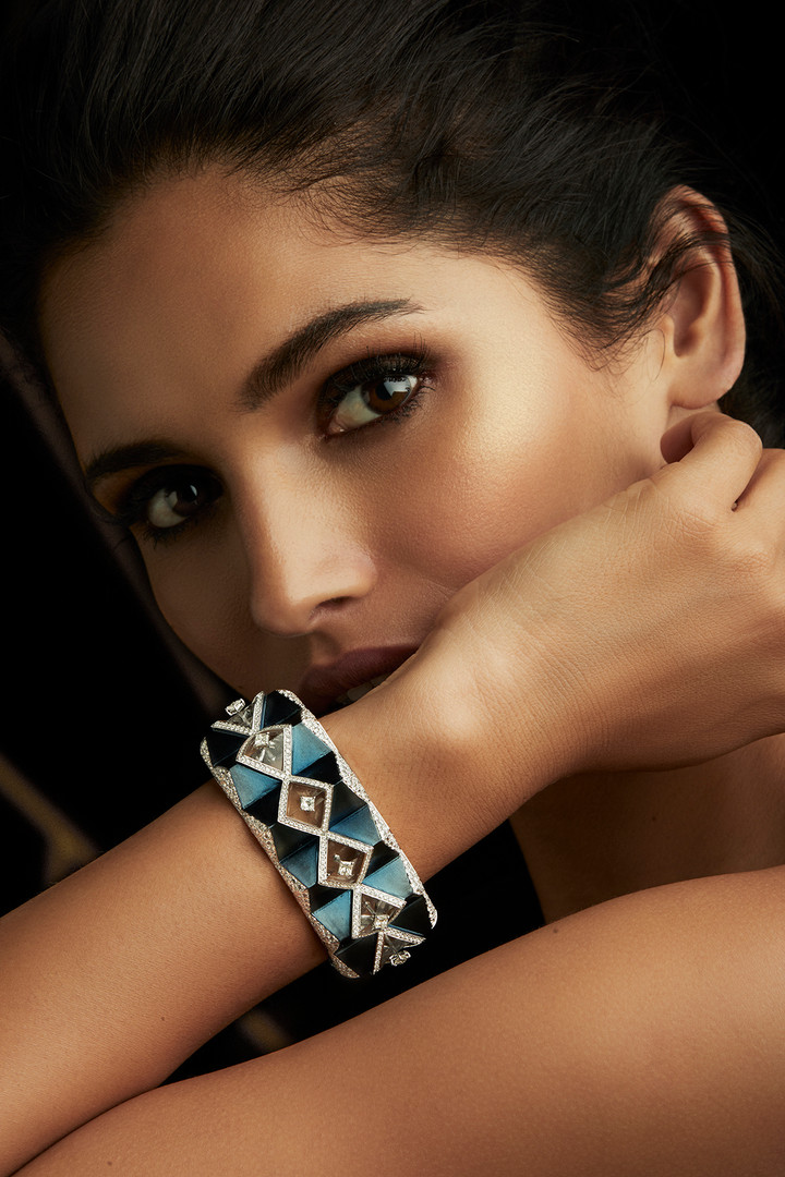 SYMMETRY THAT EMBODIES PERFECTION - CAPTURED IN THIS DIAMOND & CRYSTAL CUFF, WITH METALLIC TEAL ENAMELLING.