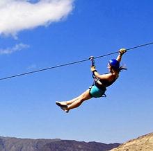Ziplining girl blue sky.jpg
