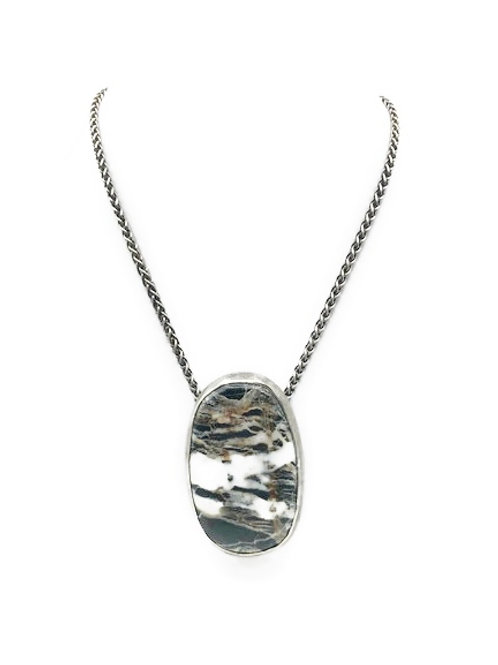 Large oval necklace featuring white buffalo turquoise set in sterling silver.