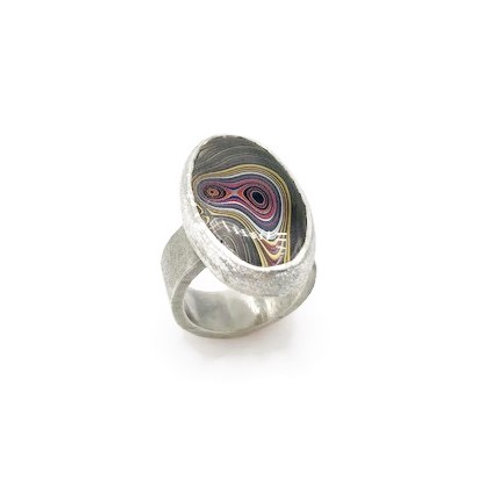 A small oval Fordite ring in sterling silver.
