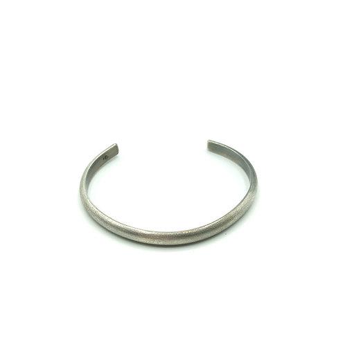 Half round cuff bracelet in sterling silver.