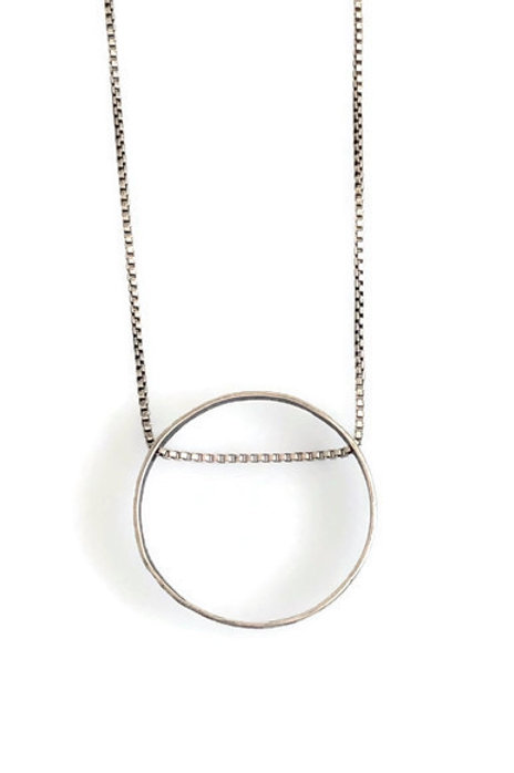 Open circle necklace in sterling silver.
