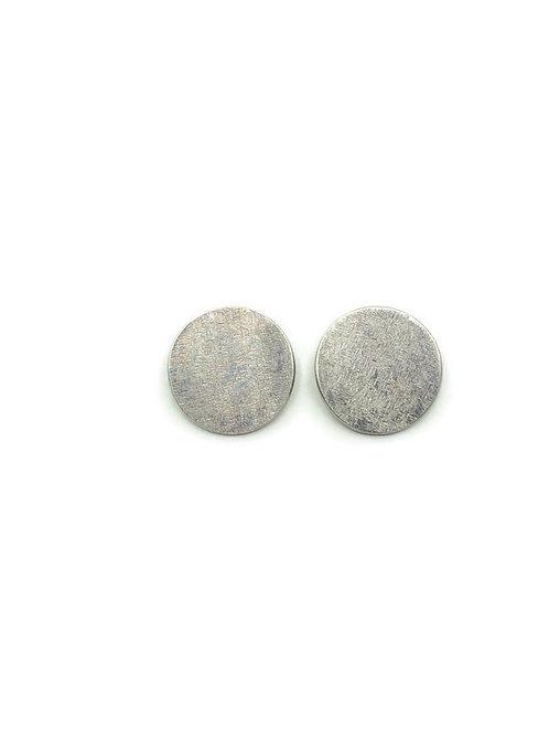 Large circle stud earrings set in sterling silver.