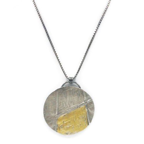 Silver and 24K gold fold forming large pendant necklace.