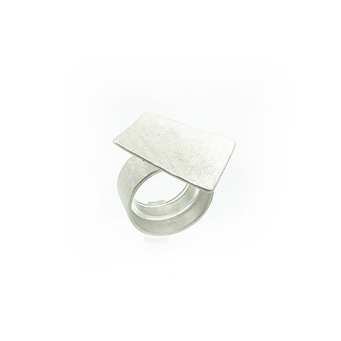 A square ring set in sterling silver.