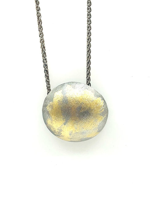 Abstract half dome necklace with sterling silver and 23K gold foil.