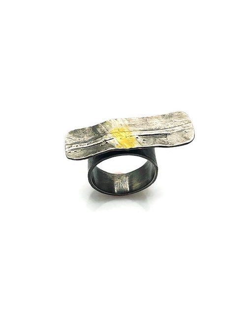 Silver and gold fold forming tab ring.