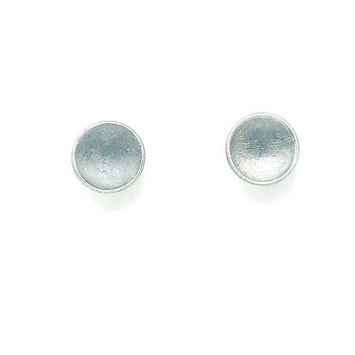 Circle stud earrings set in sterling silver.